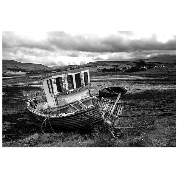 Boat in black and white on land