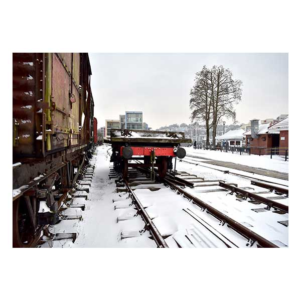 Picture showing trains, snow, houses, rail tracks