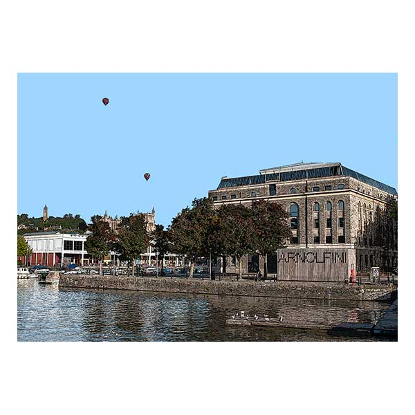 hot air balloons over water and a building