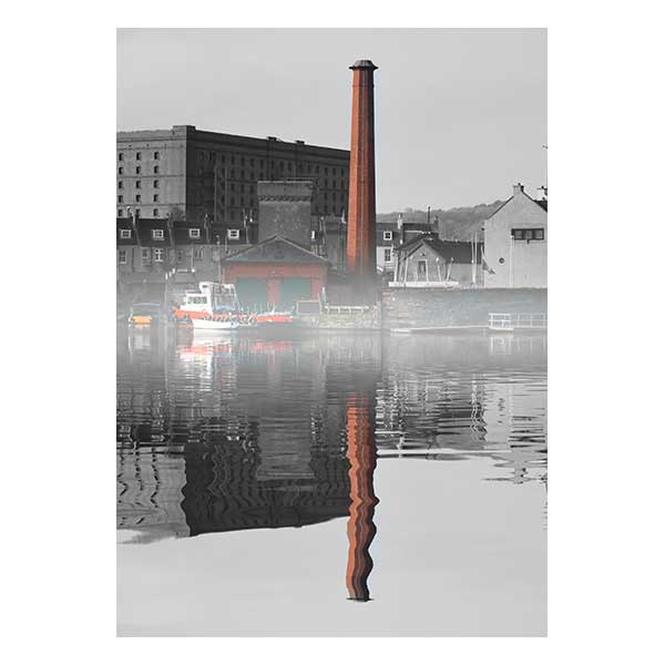 Boatyard in fog with buildings in background